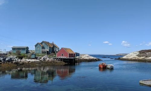 east coast community with colourful houses overlooking a bay