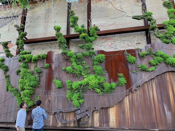 Two men standing outside of Evergreen Brickworks