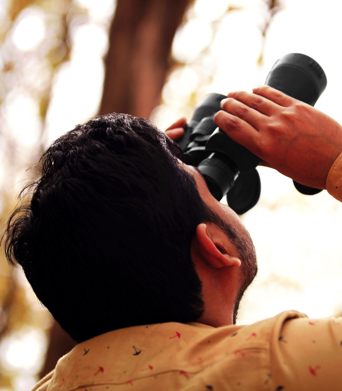 Man birding with binoculars