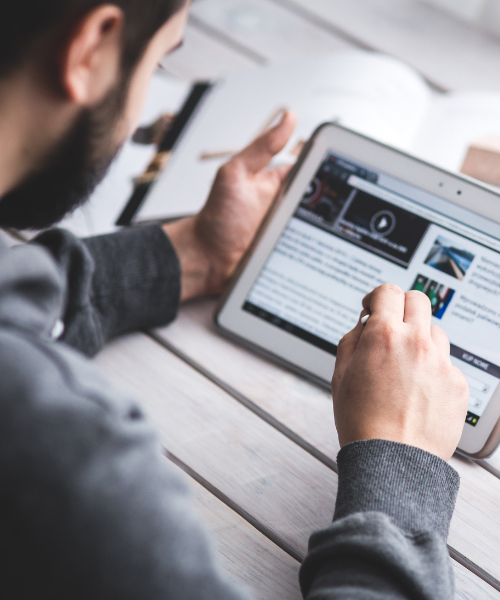 Man looking at news content on tablet