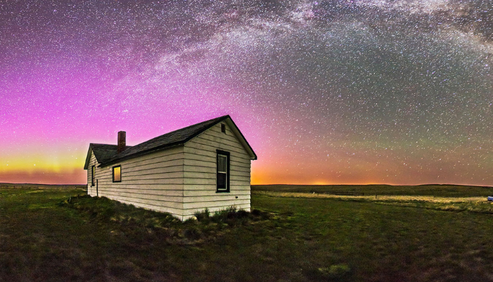 House in field with starry sky
