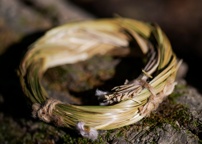 Sweetgrass wreath on log