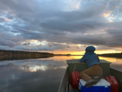 Person on boat at sunset