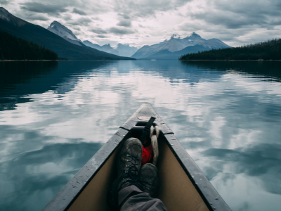 Person in canoe on lake in mountains